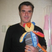 Chris Noth with a Patchwork Bear Baby clothes bear